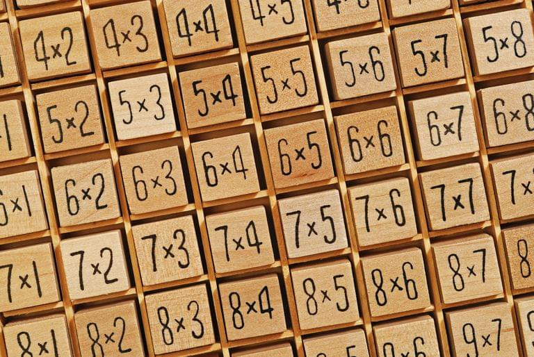 elementary school child doing math problems
