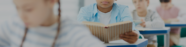 elementary school child reading book