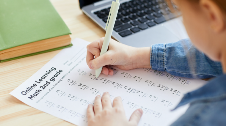 elementary school student doing math homework