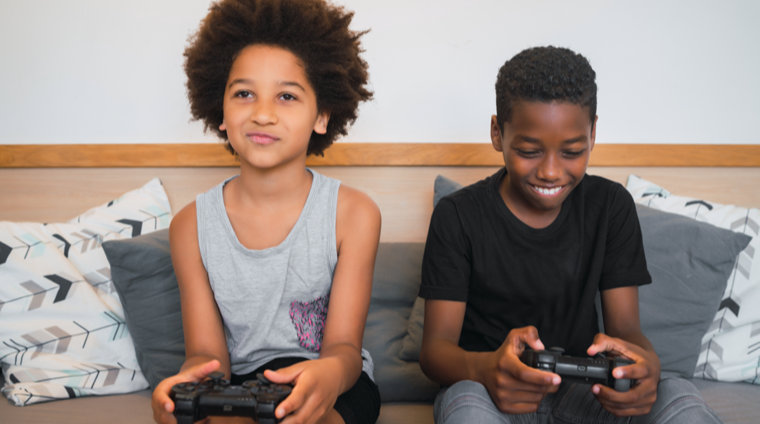 two elementary school children playing video games