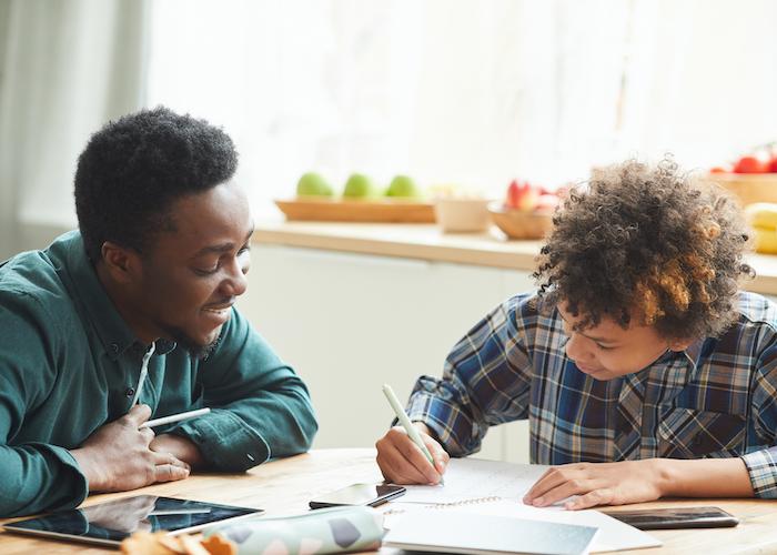 tutor and student writing