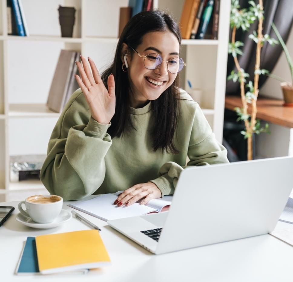 tutor waving to student on computer