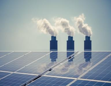 solar panels and factory smoke