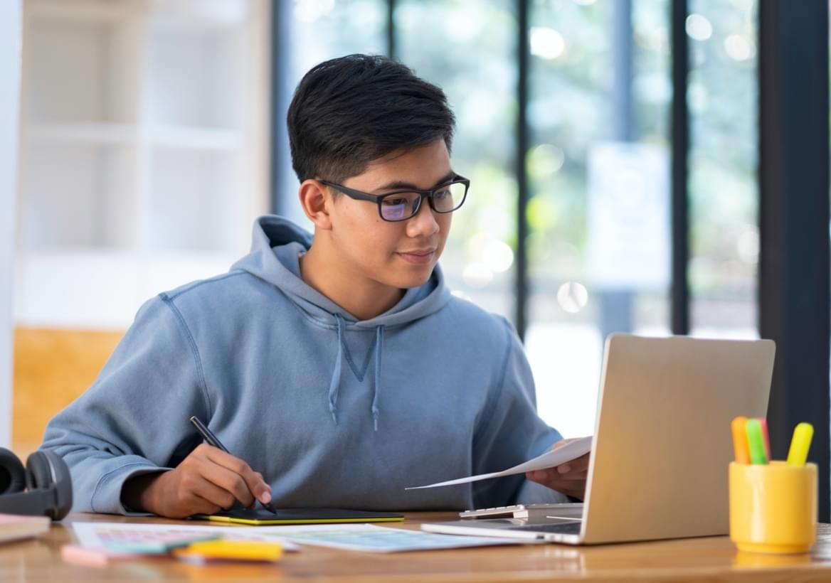 grade 9 student studying in front of computer